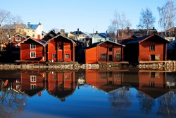 Porvoo, Finland. Classic old wood houses and their reflection in river