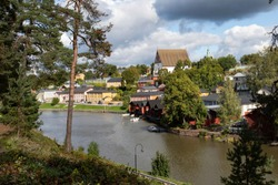 Porvoo, Finland. Embankment of the city of Porvoo. View of the Cathedral of the Blessed Virgin Mary