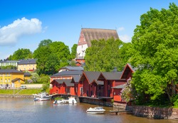 Porvoo landscape in summer. Small historical town in Finland. Old red wooden houses and trees on the coast