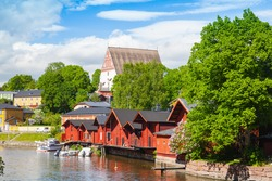 Porvoo landscape. Small historical town in Finland. Old red wooden houses and trees on the coast