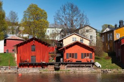 Porvoo town view on a sunny spring day, Finland. Old red wooden houses on the river coast