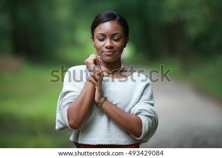 Stock Photo posing african, american black, girl adult fashionable model, feeling moments, enjoying, closed eyes dark style