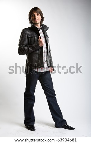 posing man in black jacket