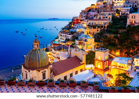 Positano, Amalfi Coast, Campania, Sorrento, Italy. View of the town and the seaside in a summer sunset #577481122