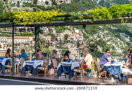 POSITANO ITALY MAY 06 2015 Unidentified people at restaurant looking to Positano Amalfi Coast Italy
