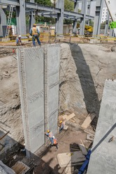 Positioning a huge construction surrounding wall or tilt-up panel Construction frame made of reinforced precast concrete and steel rods