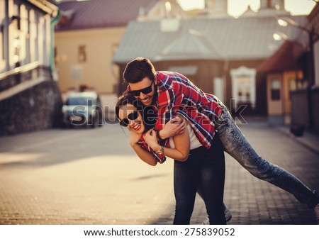 positive and carefree couple having fun in city stock photo