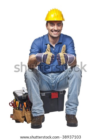 positive and confident young caucasian handyman sit on toolbox