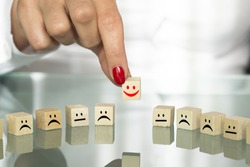 Positive attitude concept with business woman hand choosing happy face mindset