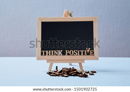 Positive Attitude, Happy and optimistic thinking Concept. The inscription think positive on the blackboard. Mockup