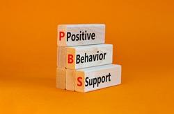 Positive behavior support symbol. Concept words Positive behavior support on wooden blocks on a beautiful orange background. Business, psychological and Positive behavior support concept. Copy space.