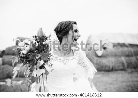 Positive bride with the bouquet looks to the side #401416312