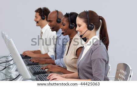 Positive business partners with headset on working in a call center - stock photo