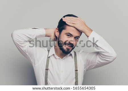 Positive businessman representative man look mirror prepare work classy meeting enjoy haircare procedure touch hands hairdo wear stunning outfit isolated over grey color background
