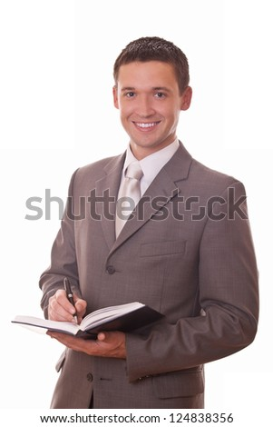 positive businessman with notepad in hands on white background
