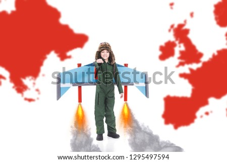 Positive confident cheerful boy imagining flying with jet pack wings all around the world, White background with world map, Child imagination