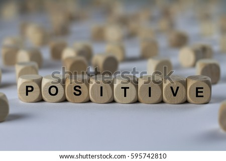 positive   cube with letters ...