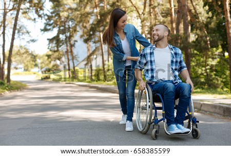 Positive delighted disabled man expressing positivity