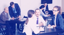 positive english people working productively on business project together in office