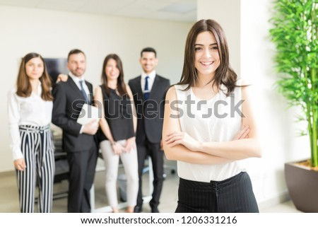 Positive female business tycoon smiling while leading organization #1206331216