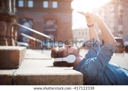 Positive guy lying on the footsteps  #417122338