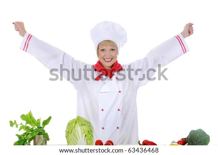 Positive handsome chef prepares vegetables. Isolated on white background