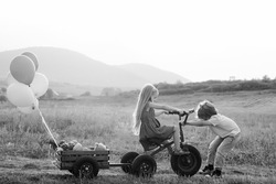 Positive little girl and boy. Cute young boy and girl. Happy little kids. Emotional little girl and boy on a walk. Happy kids smiling and having fun