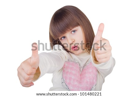 Positive little girl showing a thumbs up isolated on white background