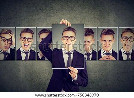 Positive masked man in glasses expressing different emotions  #750348970