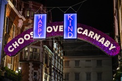 Positive messages in front of Carnaby Street illuminated arch at the 2020 Christmas lights paying tribute to frontline workers during the Coronavirus pandemic