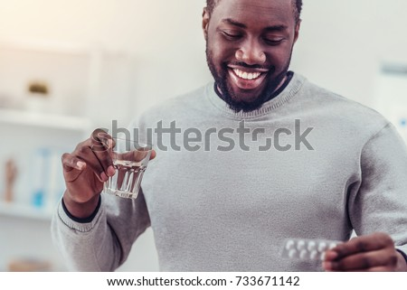 Positive minded African American man taking medication #733671142