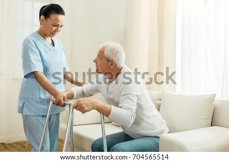 Positive nice woman working as a caregiver
