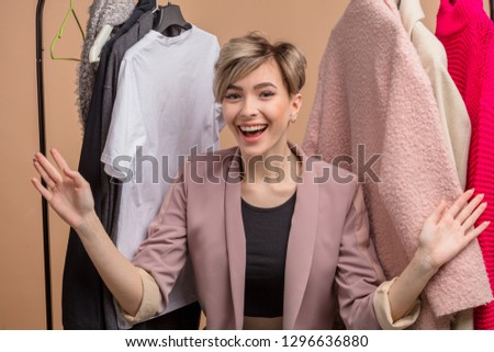 positive seller greeting people in the store. politeness and kindness concept
