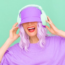Positive smile Dj Girl in stylish headphones and bucket hats. Minimal monochrome pastel colours design trends