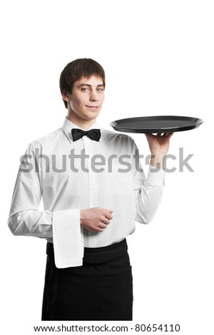 Positive Waiter man with empty restaurant tray isolated on white