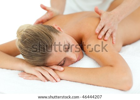 Positive woman enjoying a massage in a spa center