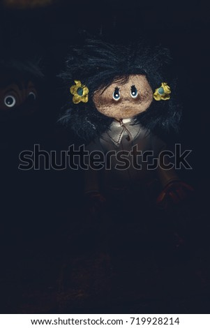 Possessed dolls emerge from darkness. Halloween nightmare. Original photo of ancient toy (copyright free) retouched and colored, neither artworks, layers nor external references were used