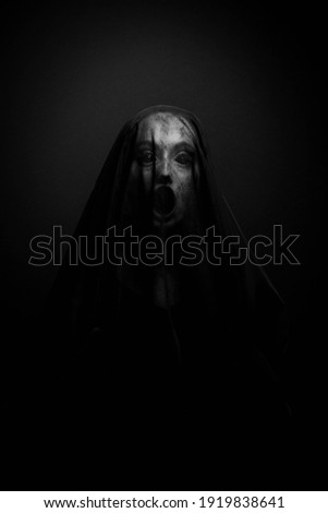 Possessed Woman screaming with her face covered Photo stock ©