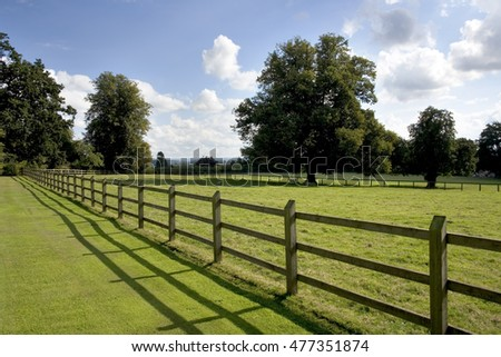 Post and rail fencing around a tidy paddock