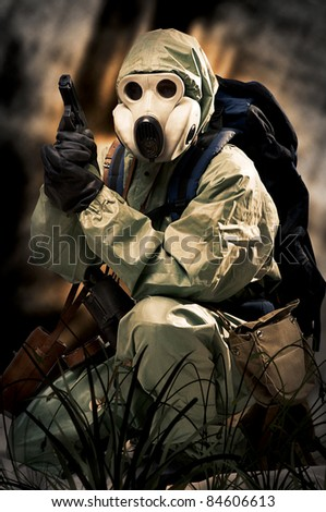 Post apocalypses world halloween concept. Portrait of man in gas mask. Protective military chemical warfare suit