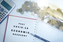 Post covid-19 economic recovery conceptual. Top view of an image with 'POST COVID-19 ECONOMIC RECOVERY