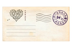 Post envelope with  Canada postage stamps and prints.Heart shape created of flying pigeons. Love Canada.  Vintage style. Isolated on a white