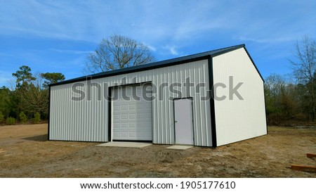 Post frame storage shed perfect for lawnmowers, trailers, ATV's, vehicles, boats, any recreational activities