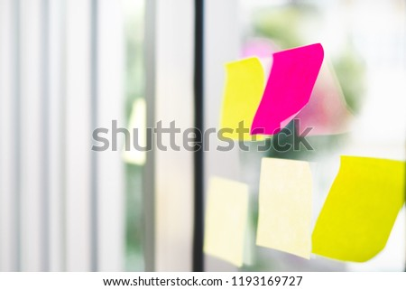 Post sticker note on mirror window, working in office concept #1193169727