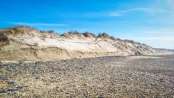 Post-storm eroded dune in Esposende, Portugal. Sand loss from a dune under wave attack.