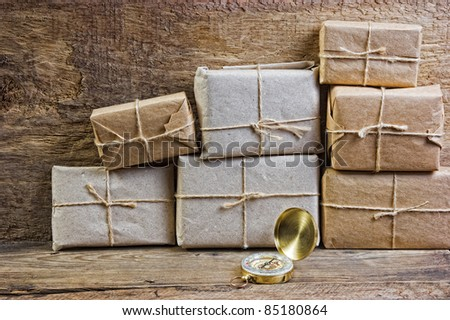 Postage on the background of an old wooden board