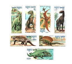 Postage stamps with the image of dinosaurs in 1976, laid out on a white background. Stamps can be redeemed in different categories and prices. The concept of philately hobby.