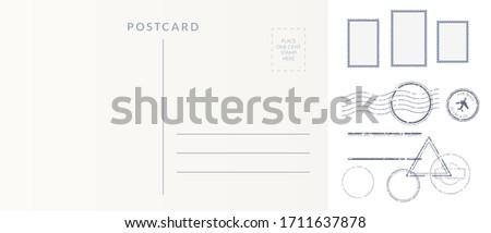Postal elements set: empty postcard back, postage stamps and cancel marks imprints