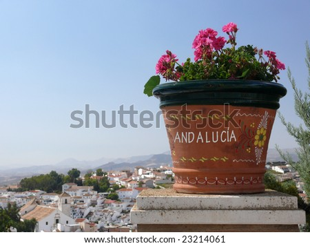 Postcard form Andalusia. Inscription, flowers, white town (Colmenar) and summer.