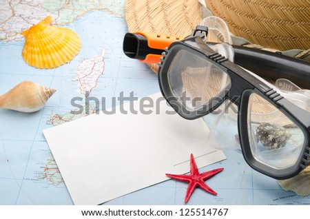 Postcard, mask and snorkel diving on the map